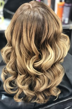 A tired box colour was revamped using a balayage highlighting technique