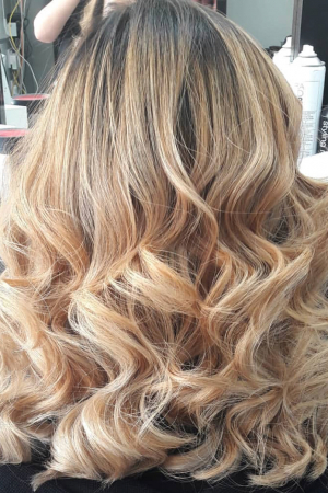 This Balayage was created from a very tired and orangey toned Blonde using balayage highlighting technique