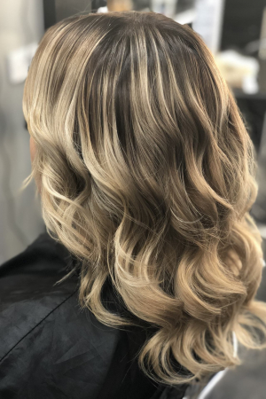 A gorgeous Balayage result on a client That had old highlights. A root stretching technique was used to create this final look